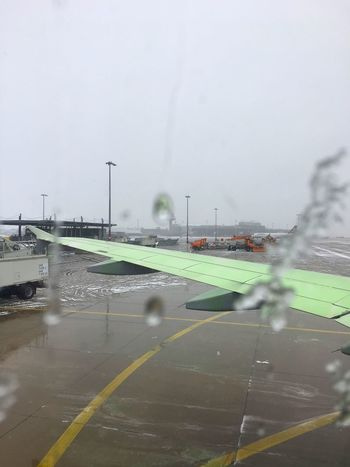 Deicing Wintertime Airport Aircraft Wing Aircraft Wing turning green through Deicing Fluid