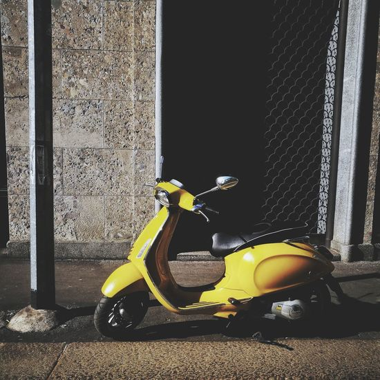 Yellow Colors Yellow Getty X EyeEm Streetphotography Streetphotographer Getty Images Urban Photography Urbanphotography Vespa Close-up Scooter Parking Mode Of Transport Motor Scooter Building Vehicle