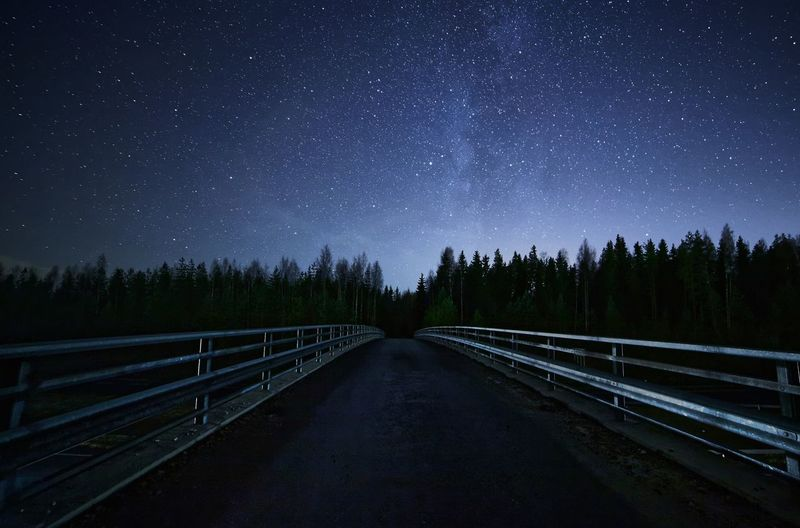 Mysterious road to the stars at night. Astronomy Beauty In Nature Constellation Darkness Galaxy Milky Way Mysterious Mysterious Place Nature Night Night Photography Nightphotography No People Outdoors Perspective Road Scenics Sky Space Space Exploration Star - Space Star Field Stars Stars At Night Twilight