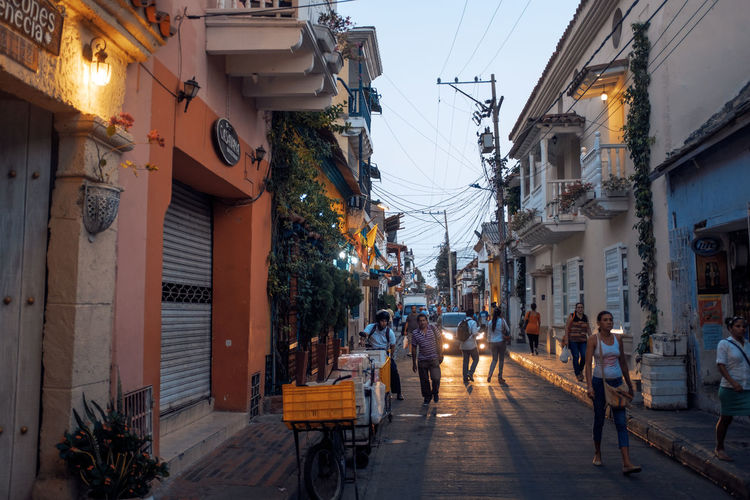 Busy street scene at twilight in Cartagena. Backlight Busy Cables City Illuminated People Shadows Street Light Twilight Vibrant Color