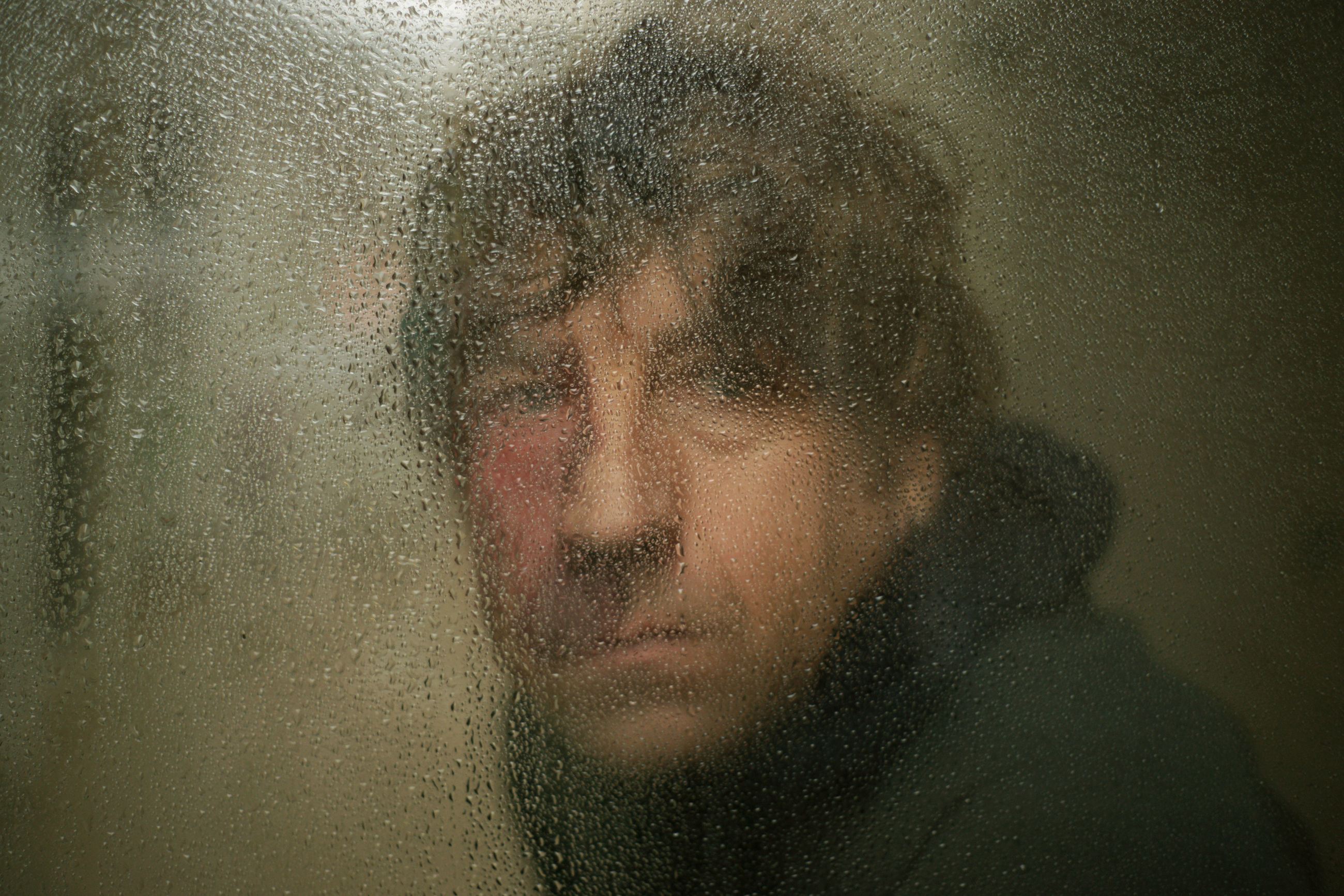 rain, wet, window, drop, one person, loneliness, looking through window, lifestyles, beard, raindrop, water, indoors, close-up, headshot, real people, adult, one man only, only men, men, adults only, people, day, portrait, young adult