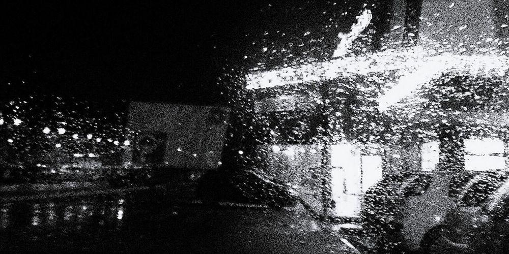 Close-up of wet window at night