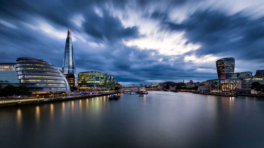The Shard in London with the Thames and City Hall with storm clouds rising Cloud Dark Dramatic Sky England, UK London Modern Storm Thames Travel Architecture City Cityscape Cloud - Sky England Long Exposure Night No People Riverbank Shard Sky Skyscraper Travel Destinations Uk Urban Skyline Water