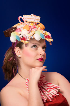 Retro candy 90s 90s Candy Store Retro Retro Candy 90s Snack Sugar Adult Beautiful Woman Beauty Blue Blue Background Candy Candy Corn Chocolate Candy Colored Background Front View Hairstyle Headshot Indoors  Leisure Activity Lifestyles Make-up One Person Portrait Studio Shot Sweet Food Teenager Women Young Adult Young Women