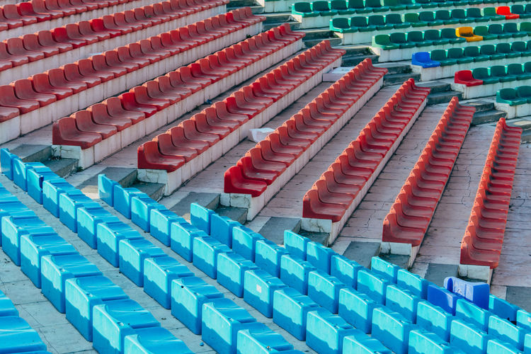 High Angle View Of Multi Colored Empty Chairs In Stadium