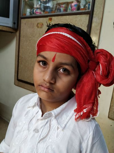 Portrait of boy in traditional clothing at home