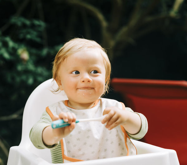 Portrait of cute boy holding baby girl