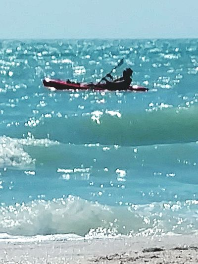 Kayaking Rough Seas Kayaker Kayaking The Gulf Fun Sports Paddling Ocean Waves Rip Tides Moving Along Beach Photography Beach Lifestyle Salt Life Therepy Enjoying The View Gulf Of Mexico From A Distance Zoom In Enjoying Life Beach Day Man In Kayak