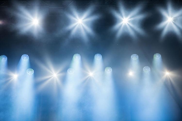 Illuminated stage lights at music festival