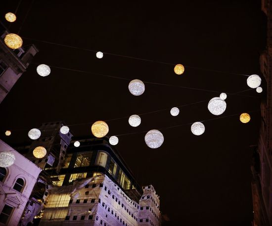 Lights above Regent Street in December Street Photography Streetphotography Balls Lighting Low Angle View Built Structure Architecture Illuminated Lighting Equipment Hanging No People Sky City Building Exterior Night