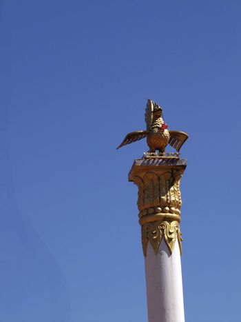 Buddhist Ceremonial Column Animal Representation Bird Blue Sky Buddha Buddhism Buddhist Architecture Buddhist Art Buddhist Symbol Ceremonial Column Column Communication Gold Coloured Inle Lake Kakku Myanmar Outdoor Photography Place Of Prayer Place Of Worship Religion Shan State Tourism Tourist Attraction  Tourist Destination Unusual