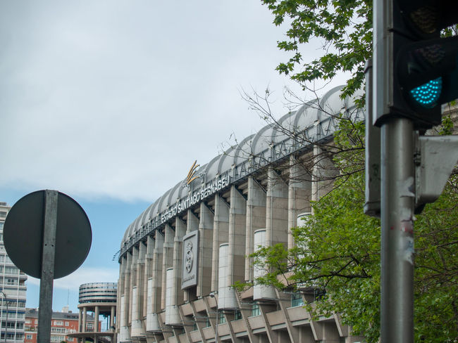 Architecture EyeEm Best Shots EyeEmNewHere Football Geometric Architecture Santiago Bernabéu Stadium Sport In The City Stadium Teamwork Urban Lifestyle Architectural Column Architectural Feature Architecture Building Building Exterior Built Structure City Cloud - Sky Communication Day First Eyeem Photo Geometric Abstraction Glass - Material Lifestyles Low Angle View Nature No People Outdoors Plant Road Road Sign Santiago Bernabeu Sign Sky Sport Sport Building Still Life Street Team Team Sport Tree