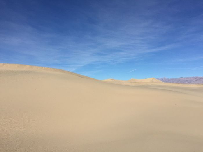 Scenic view of mesquite flat dunes against sky