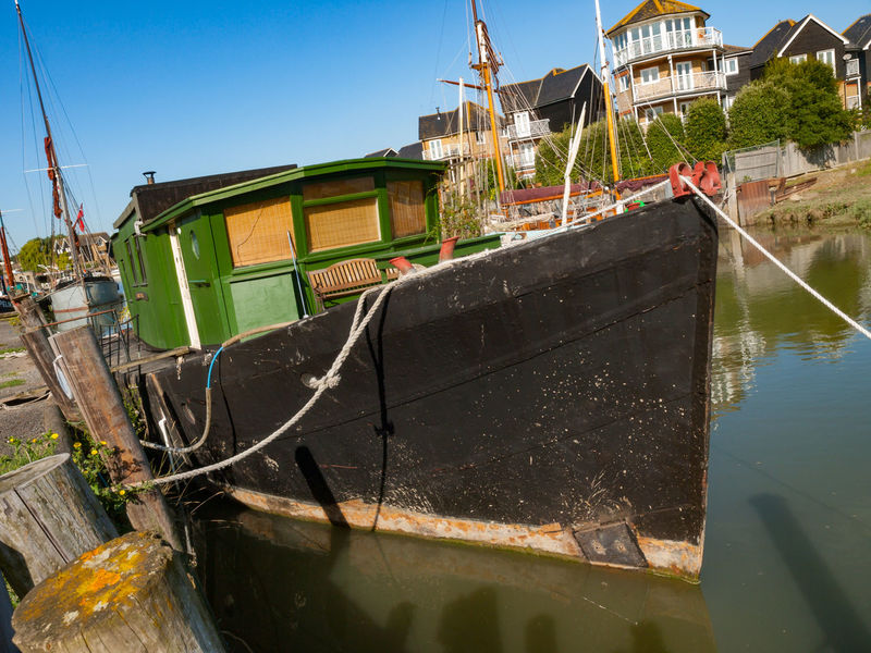 Faversham Iron Wharf Kent Architecture Boatyard Building Exterior Built Structure City Clear Sky Day Faversham Iron Whafe Kent Nautical Vessel No People Outdoors Red Sails Sky Sunlight Thames Barge Tourism Travel Travel Destinations Vivid International Water Wharf Wooden Boat