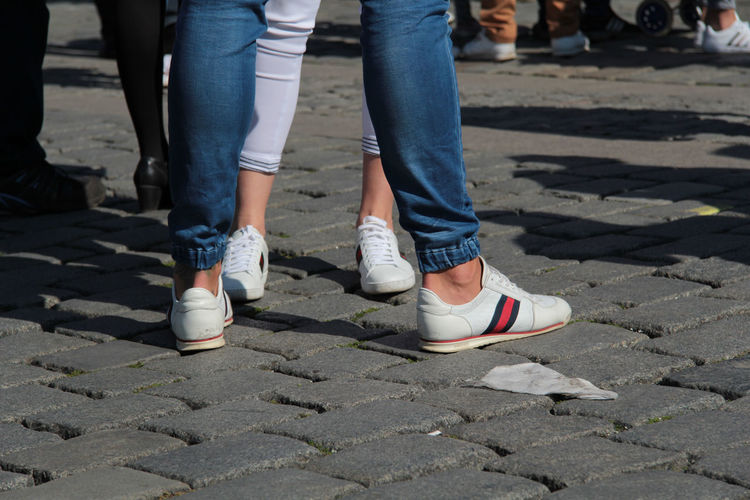 Low Section Human Leg Shoe Body Part Human Body Part Real People Jeans Day Street City Footpath Standing Leisure Activity Lifestyles Women People Outdoors Sunlight Two People Togetherness Human Foot Human Limb Shoes Trainer Prague Fashion Trendy White Background