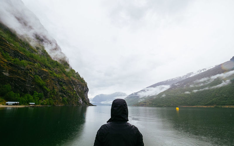 Lost In The Landscape Norway Adult Beauty In Nature Day Fjord Headshot Lake Leisure Activity Lifestyles Mountain Nature One Person Outdoors People Real People Rear View Scenics Sky Standing Tranquility Water Women