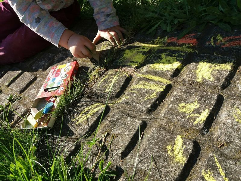 Shadow Sunlight Low Section Real People Outdoors Grass No Head Colors Pathway Path In Nature Colorful Path Artist At Work Human Body Part Colorful Sitting On The Ground Little Artist Art Is Everywhere Creativity Arte Ornaments Chalkpastel Chalkboard Chalk Drawing Little Girl Sitting