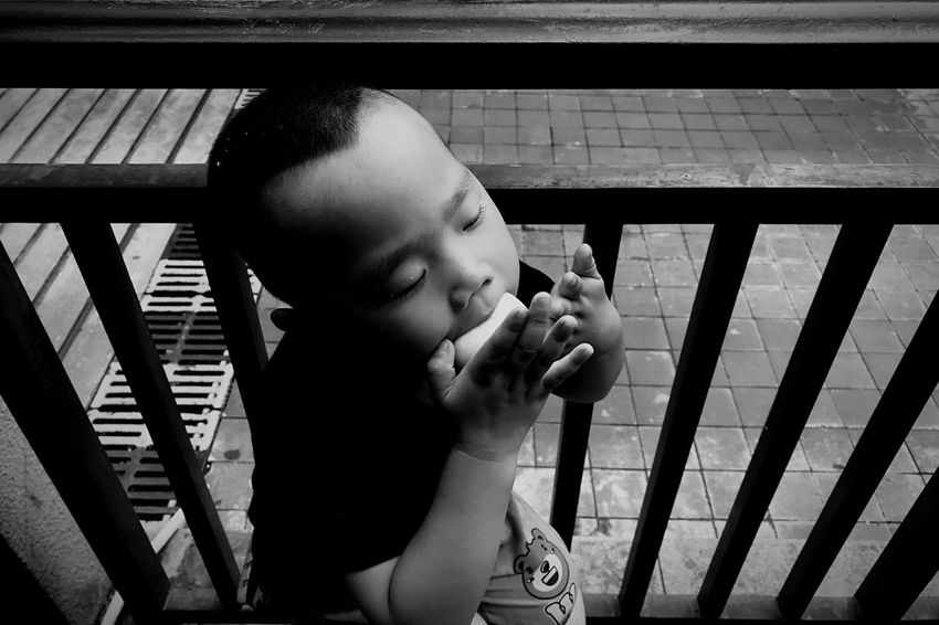 The Portraitist - 2018 EyeEm Awards Child Childhood One Person Real People Innocence Lifestyles Indoors  Males  Cute Holding Toddler  Men Baby Leisure Activity Boys Food And Drink Young Headshot Looking People Watching IPhoneography Streetphotography Streetphoto_bw The Street Photographer - 2018 EyeEm Awards