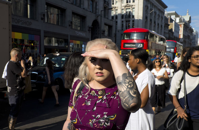 Stylish woman with tattoos walking in Oxford Street on 3rd of July 2018 in London, United Kingdom. (photo by Lorenzo Grifantini) London Oxford Shoes Adult Casual Clothing City City Life Crowd Lifestyles Outdoors Tattoo Women