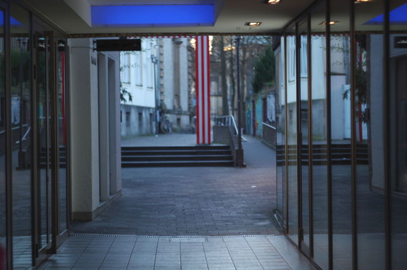 passage in Münster, germany, during sunset Architecture Built Structure Building No People Direction Indoors  Illuminated Night Flooring Empty Door The Way Forward Entrance Absence Arcade Tile Corridor Architectural Column Tiled Floor Münster Münsterland