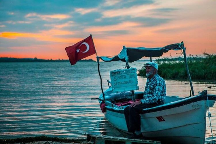The Portraitist - 2017 EyeEm Awards Gölyazının Osman amcası Water Flag River Nautical Vessel Cloud - Sky Sky Nature Transportation Outdoors Sunset Real People Day Beauty In Nature One Person People