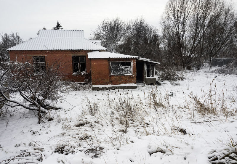 abandoned house covered by snow Home Winter Abandoned Architecture Bare Tree Beauty In Nature Building Exterior Built Structure Cold Cold Temperature Covered Day Destroyed Empty Frozen House Nature No People Outdoors Scenics Sky Snow Snowing Tree Weather White White Color Winter
