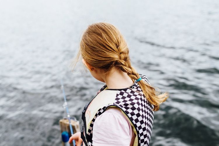EyeEm Selects Water Rear View One Person Real People Leisure Activity Focus On Foreground Lifestyles Sea Day Outdoors Standing Women Blond Hair Nature Young Adult Young Women Adult People Adults Only Girl Fishing
