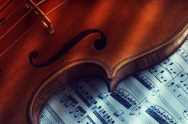 Part of a Violin Arts Culture And Entertainment Classical Music Close-up Indoors  Light And Shadow Music Musical Instrument Musical Instrument String Musical Note No People Paper Sheet Music String Instrument Violin