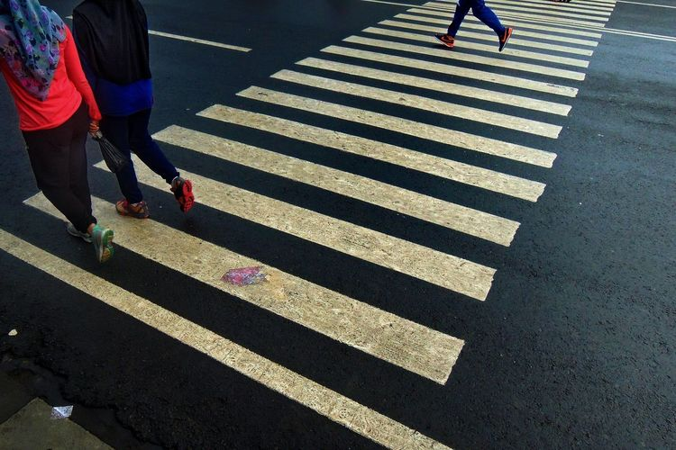 Low section of people on zebra crossing