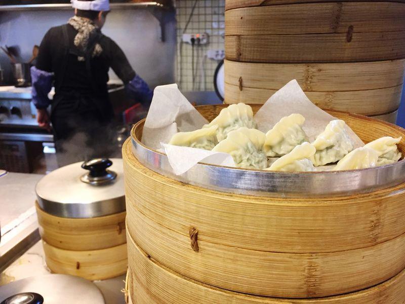 Dumplings in the cafe Restaurant Asianfood Steamed Dumplings Food And Drink Real People Food Freshness Working Dumpling  Occupation