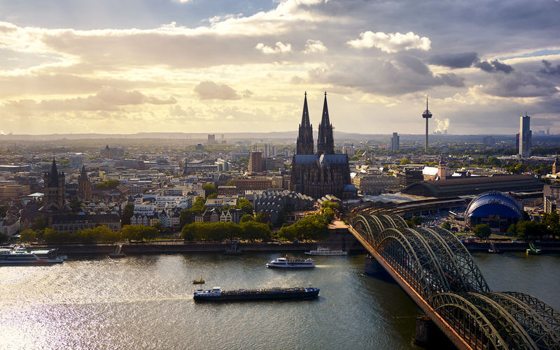 Cologne Cathedral Koelner Dom seen from the top of Cologne Koeln Triangle building Cathedral Church City Cityscape Cologne Dom German Great Saint Martin Church Köln Kölner Dom Panorama Panoramic Travel Aerial Architecture Best  Bridge Building Building Exterior Dome Germany Hohenzollern  Hohenzollernbrücke Köln Triangle Religion