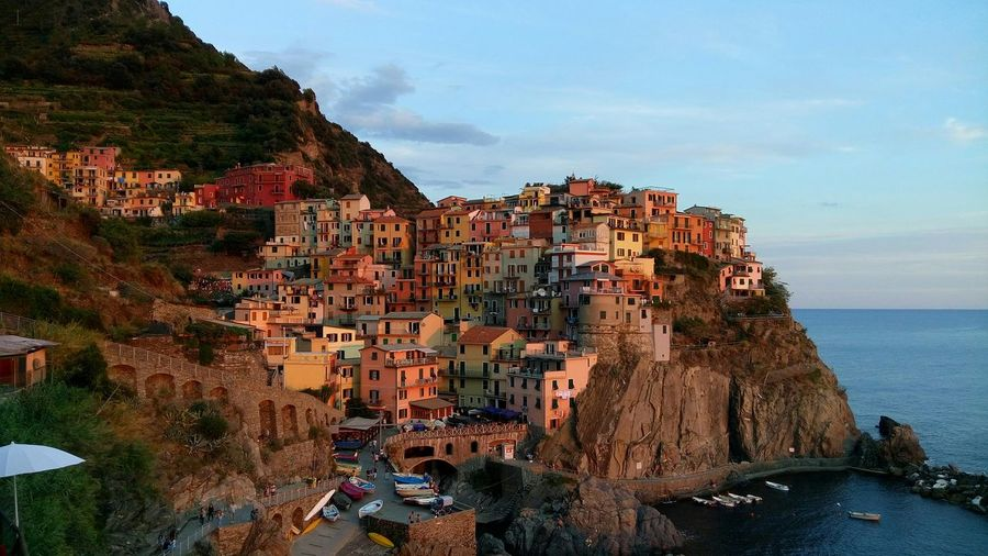 Houses at cinque terre against sky at sunset