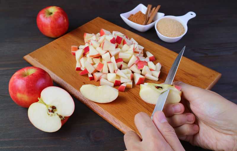 High angle view of chopped fruits on cutting board