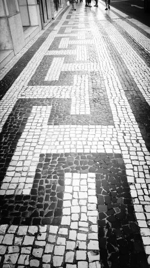 Calçada Portuguesa.. Lisbon Portuguese Tiles  The Street Photographer - 2014 EyeEm Awards Eyeem Monochrome EyeEm Best Shots - Black + White I LOVE PHOTOGRAPHY High Angle View Day Shadow Tile Outdoors Real People Low Section One Person People