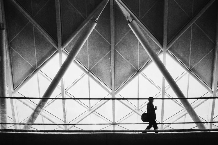 Silhouette Of Person On Elevated Walkway