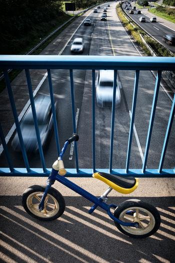 High angle view of bicycle on railing