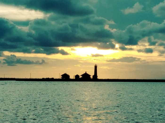 Water Sunset Sea Silhouette Sky Architecture Building Exterior Horizon Over Water Cloud - Sky Built Structure Lighthouse Coast Scenics Tranquil Scene Dramatic Sky