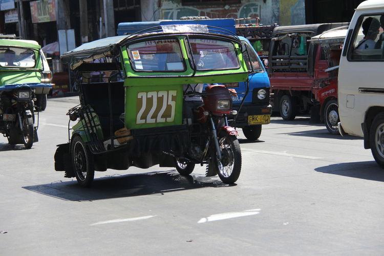 Jinrikishas on city street
