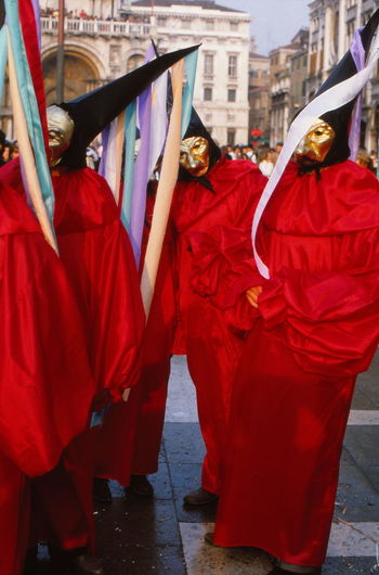 People in red costume during venice carnival