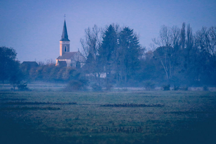 No People Nature Saône River Saône Et Loire Riverside Dawn Of A New Day Dawn Daybreak Sunrise Architecture Building Exterior Religion Built Structure Tree Belief Plant Place Of Worship Sky Spirituality Tower Land Building Field Landscape Environment Spire  Old Village French Village Fields Fog Mist