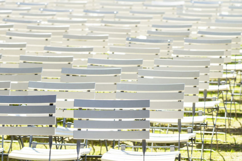 White chair rows in a spa park Absence Chair Day Empty In A Row Large Group Of Objects No People Order Outdoors Seat Side By Side White Color