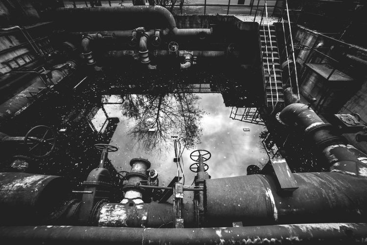 Urbex - 34 Industry Architecture Built Structure No People Building Exterior Day Pipe - Tube Metal Pipeline Factory High Angle View Transportation Nature Outdoors Water Mode Of Transportation Machine Part Machinery Equipment Pollution