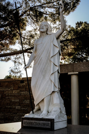 Architecture Statue Representation Tree Human Representation Sculpture Low Angle View Art And Craft Belief Plant Male Likeness Religion Day Spirituality Built Structure Nature Sky Female Likeness Creativity No People Outdoors Angel