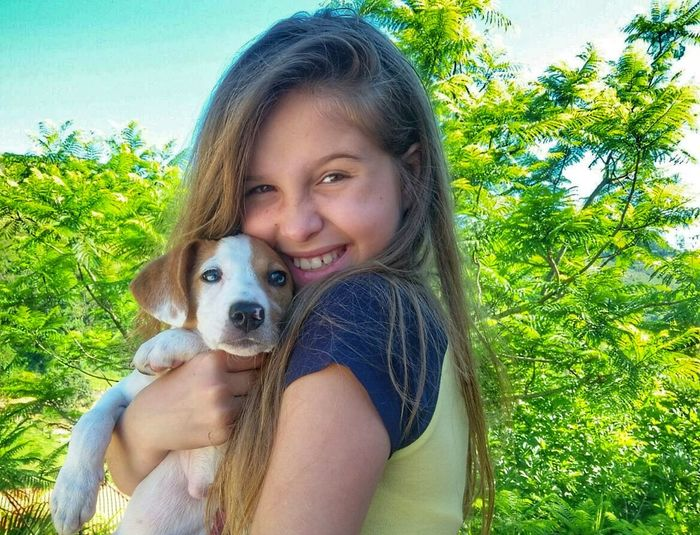 Dog Pets Portrait Looking At Camera Happiness One Animal Animal Smiling Leisure Activity One Girl Only Mammal Domestic Animals People Real People Friendship Animal Themes Lifestyles Day One Person Outdoors BlueEyes Close-up Photography Tranquility Vacations