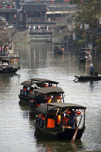 Water Towns Architecture Boat Building Exterior Built Structure China Day Ferry Inflatable Raft Large Group Of People Mode Of Transport Nature Nautical Vessel Outdoors People Real People River Sailing Tongli China Transportation Water Waterfront Yangzi Delta