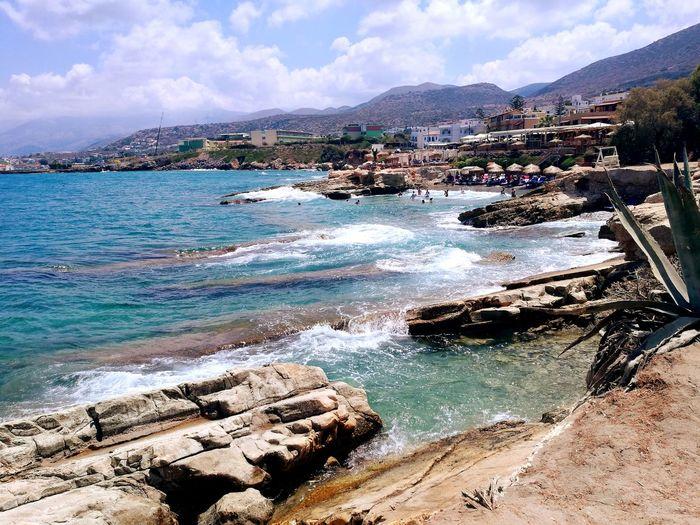 Chersonissos Crete Island Crete Greece Blue Water Mountain Sea Beach Sky Cloud - Sky Landscape Calm Wave Coast Coastline Horizon Over Water Rocky Coastline Sandy Beach Waterfront