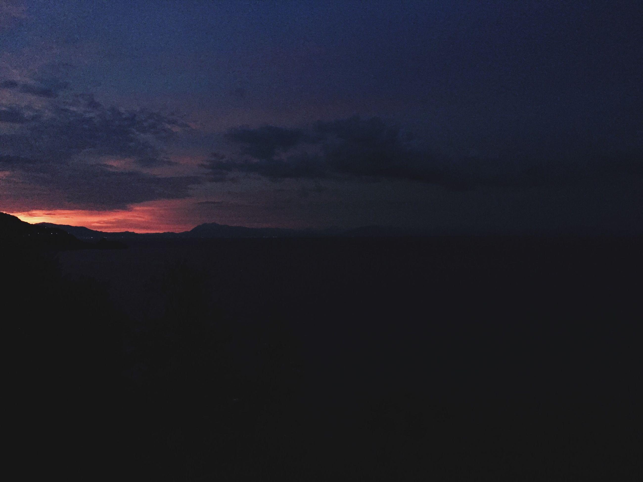 silhouette, scenics, tranquil scene, sky, sunset, beauty in nature, tranquility, nature, dark, cloud - sky, landscape, idyllic, dusk, copy space, dramatic sky, mountain, majestic, cloud, outdoors, orange color