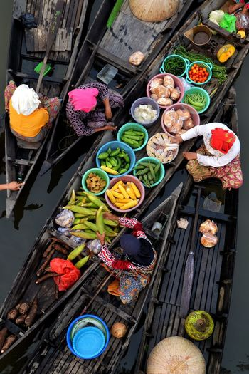 People selling vegetables on boat