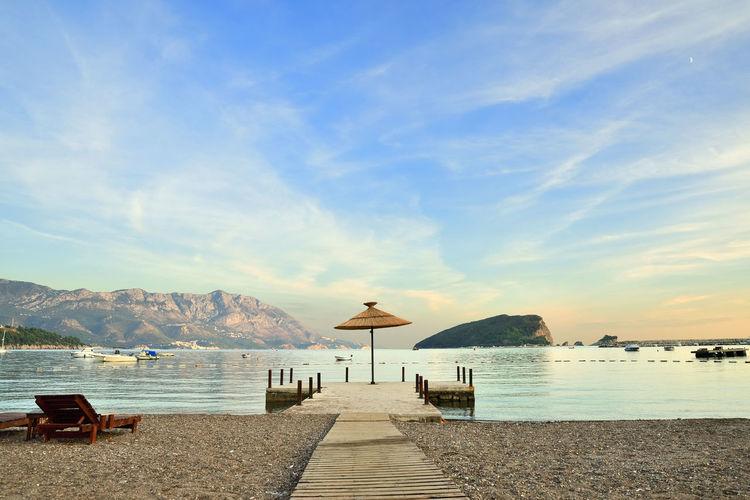 モンテネグロ/ブドヴァ 2 Water Sky Sea Scenics - Nature Beach Beauty In Nature Tranquil Scene Tranquility Mountain Cloud - Sky Land Nature Day Blue Idyllic Direction No People Outdoors The Way Forward Budva Budva,Montenegro Montenegro
