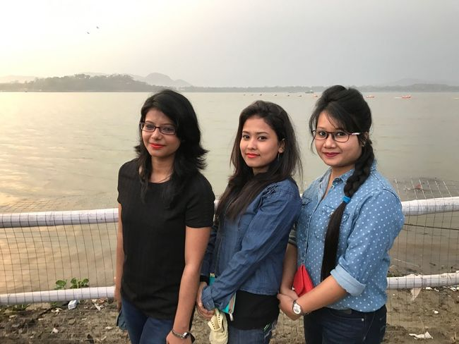 EyeEm Selects Water Real People Young Adult Young Women Standing Togetherness Sea Lifestyles Looking At Camera Casual Clothing Portrait Leisure Activity Smiling Day Nature Outdoors Friendship Mountain Beauty In Nature Scenics